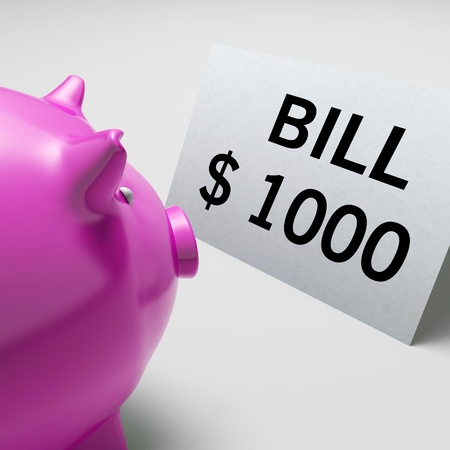 payable: Piggy bank look at Bills Dollars Showing Invoices Payable And Accounting Stock Photo