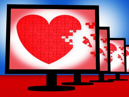 Puzzle Heart On Monitors Shows Love And Marriage photo