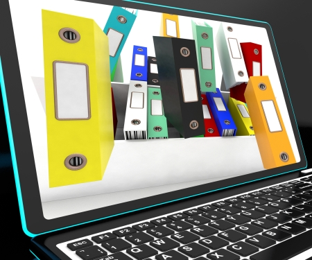 disorganized: Falling Files On Laptop Showing Unorganized Or Messy