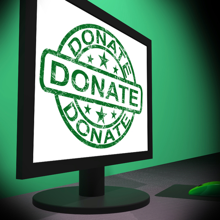 contributions: Donate Computer Showing Charitable Donating And Fundraising Stock Photo