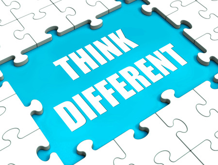 non conformist: Think Different Puzzle Showing Thinking Outside the Box Stock Photo