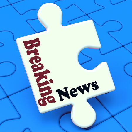 Breaking News Puzzle Showing Newsflash Broadcast Or Newscast photo