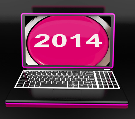 two thousand and fourteen: Two Thousand And Fourteen On Laptop Showing New Year 2014 Stock Photo