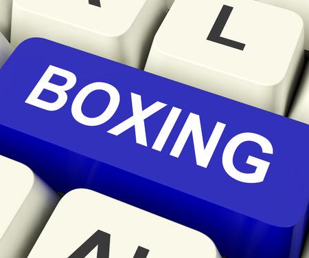 key punching: Boxing Key On Keyboard Showing Fighting Punching Or Pugilism  Stock Photo