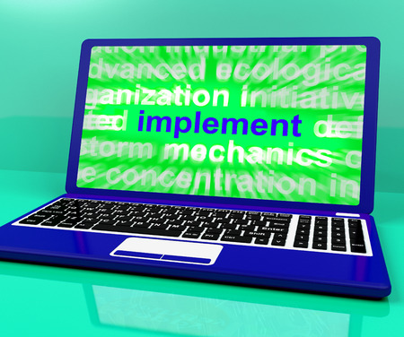 implementing: Implement Laptop Showing Implementing Or Executing A Plan Stock Photo