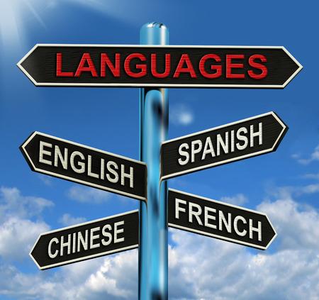 Idiomas del poste indicador Significado Inglés Chino Español y francés Foto de archivo - 26066064