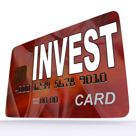 debit card: Invest on Credit Debit Card Showing Investing Money Stock Photo