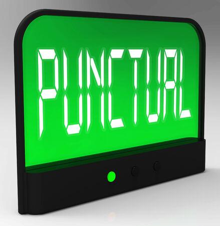 punctual: Reloj Puntual Mostrando oportuna ya tiempo Foto de archivo
