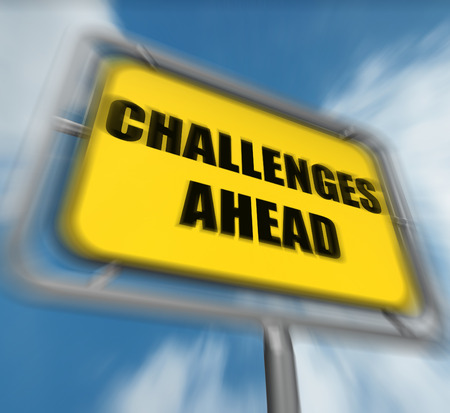 overcome a challenge: Challenges Ahead Sign Displaying to Overcome a Challenge or Difficulty Stock Photo