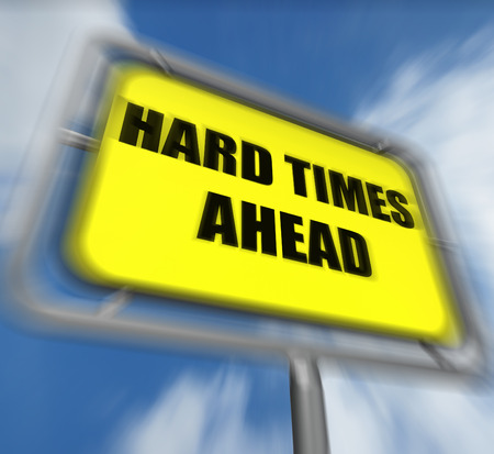 tough times: Hard Times Ahead Sign Displaying Tough Hardship and Difficulties Warning Stock Photo