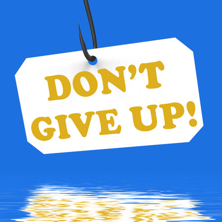 hook up: Dont Give Up! On Hook Displaying Positivity Motivation And Encouragement Stock Photo