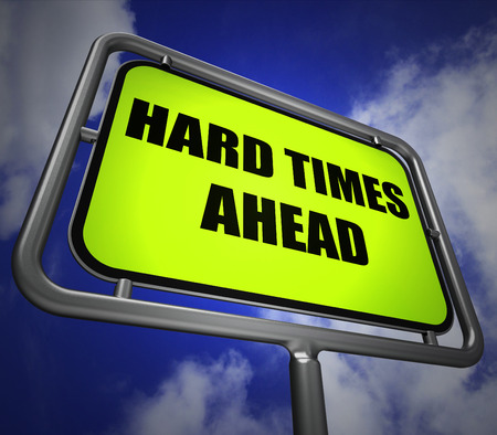 tough times: Hard Times Ahead Signpost Meaning Tough Hardship and Difficulties Warning Stock Photo