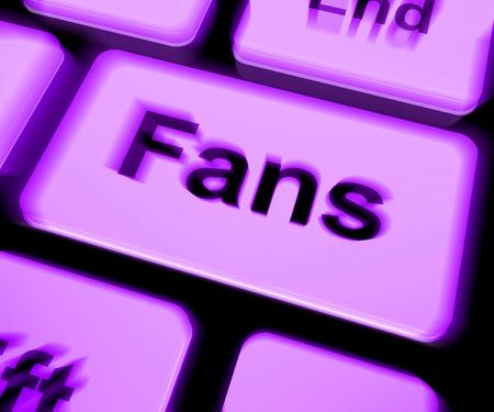 follower: Fans Keyboard Showing Follower Or Internet Fan Stock Photo