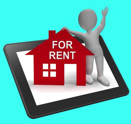 rental house: En Renta Casa Tablet Mostrando alquiler o arrendamiento del inmueble Foto de archivo