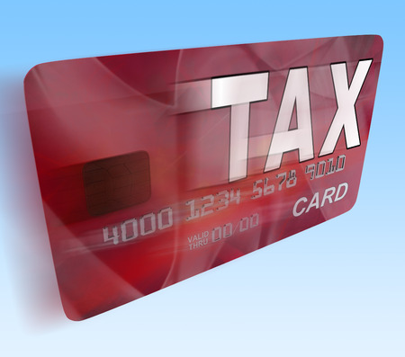 debit card: Tax On Credit Debit Card Flying Showing Taxes Return IRS Stock Photo