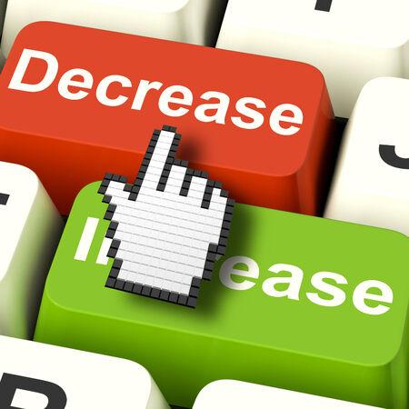 decreased: Decrease Reducing Keys Showing Decreasing Or Down Online Stock Photo