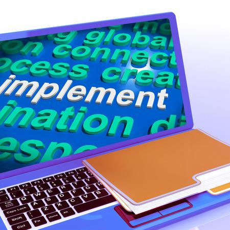 implement: Implementare Word Cloud Computer Portatile Che Mostra la realizzazione o la esecuzione di un piano Archivio Fotografico
