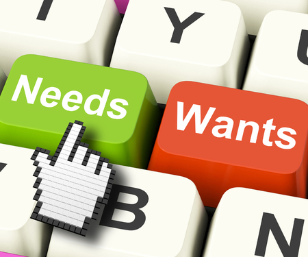 crave: Needs Wants Computer Keys Showing Necessities And Wishes Stock Photo