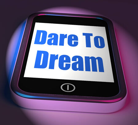 envision: Dare To Dream On Phone Displaying Big Dreams Stock Photo