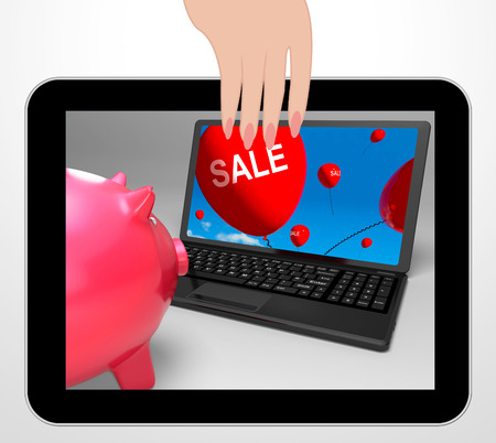 reduced: Sale Laptop Displaying Online Reduced Prices And Bargains Stock Photo
