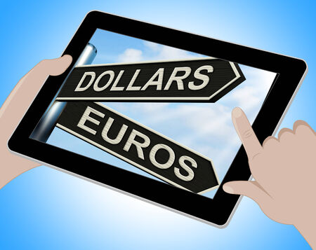 currency exchange: Dollars Euros Tablet Showing Foreign Currency Exchange Stock Photo