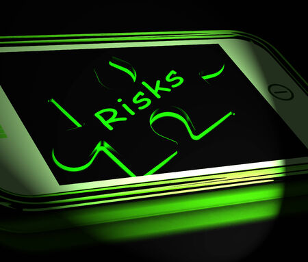 unpredictable: Risks Smartphone Displaying Unpredictable And Risky Investment Stock Photo