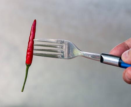 capsaicin: Chilli On Fork Showing Chili Pepper And Capsaicin