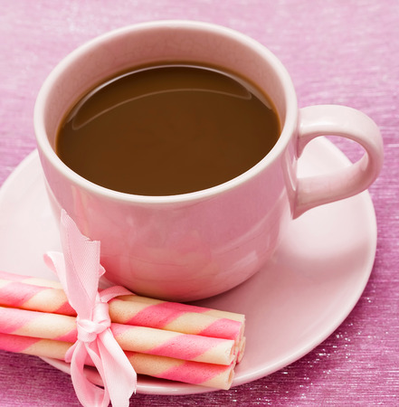hot coffees: Mug of freshly brewed coffee and strawberry cookie sticks