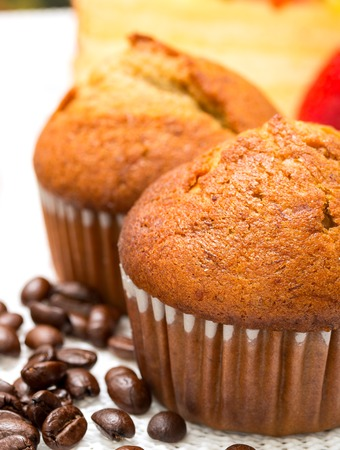 hot coffees: Coffee Muffins Indicating Hot Drink And Beverage Stock Photo