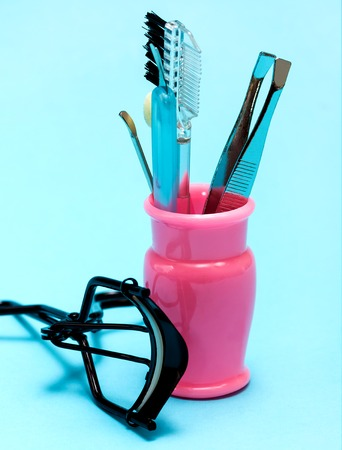 makeups: Cosmetic Makeup Tools Meaning Eyelash Curlers And Tweezes Stock Photo