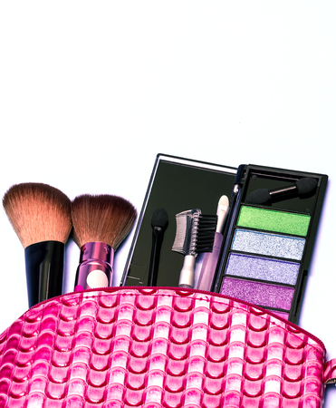 makeups: Cosmetic Makeup Kit Showing Beauty Products And Pouch Stock Photo