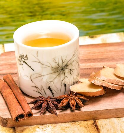 ginger tea: Refreshing Ginger Tea Indicating Cup Refreshes And Teacup Stock Photo