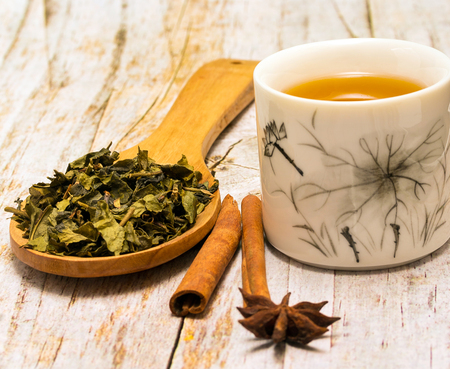 tea breaks: Green Tea Leaves Meaning Break Time And Spice Stock Photo