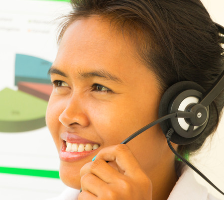 handsfree telephone: Helpdesk Support Girl Showing Call Center Assistance Stock Photo