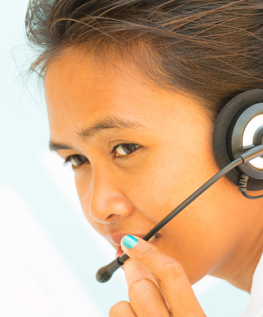handsfree telephone: Help Desk Operator Girl Showing Call Center Assistance Stock Photo