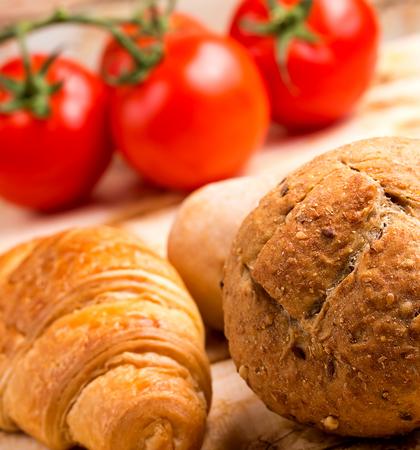 Fresh Rolls Representing Organic Bread And Tomato Stock Photo