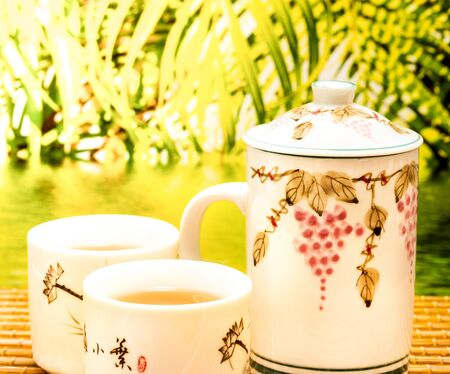 Outdoor Green Tea Showing Refreshes Breaks And Teacup Stock Photo