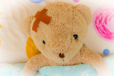 Teddy Bear In Bed With Sore Head And Plaster