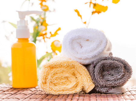Spa Themed Collage Composed of Relaxing Oils and Towels