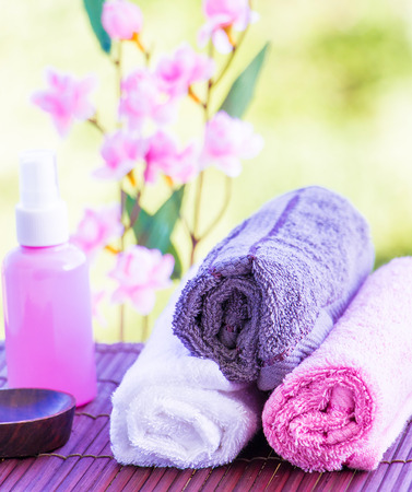 Exotic Therapy Objects Including Towels Oil and Flowers