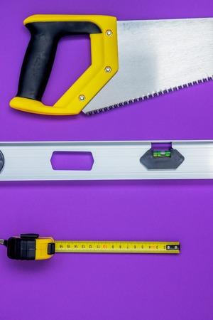 Hand tools wood saw, stapler, tape measure