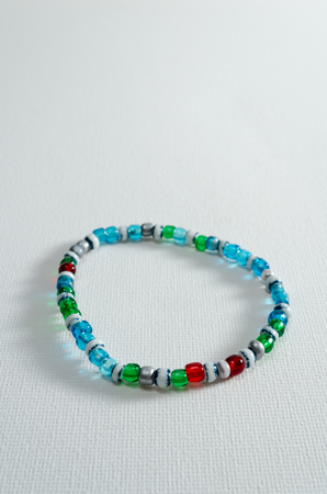 A Studio Photograph of a Multicoloured Transparent Bead Bracelet