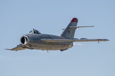 A vintage MIG-15 jet performing in an air show