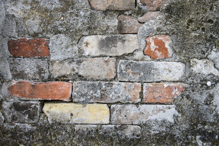Colorful but weathered bricks used to repair an above ground burial vault in St  Louis Cemetery Number One in New Orleans, Louisiana photo