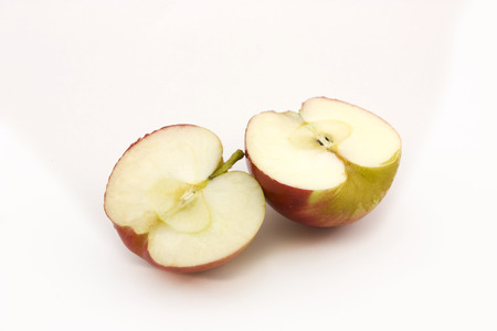 two and a half: Two half apples sliced on a white background