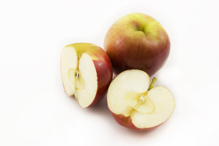 two and a half: Two half apples and whole apple sliced on a white background