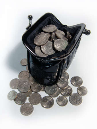 A photo of black women coin purse full of coins photo