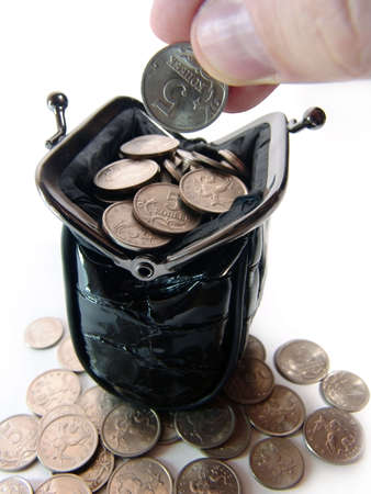 monies: A photo of black women coin purse full of coins Stock Photo