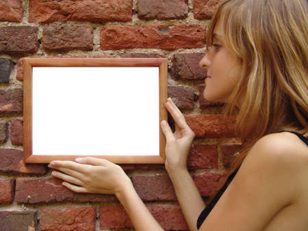 The girl with wooden frame near the grunge wall Stock Photo - 470151