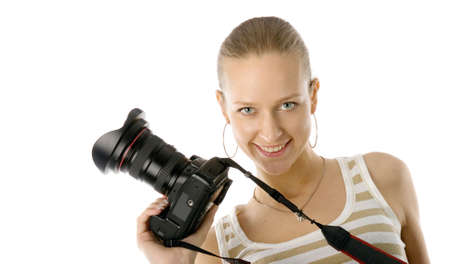 Young and beautiful fashion model posing with professional photo camera. Isolated over white background photo